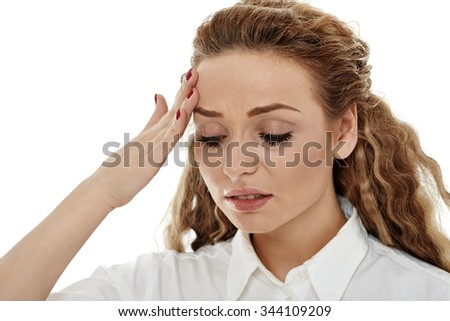 Young businesswoman having a strong headache isolated on white - stock photo