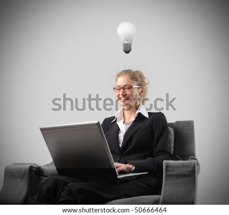 Young businesswoman having an idea while sitting and working on her laptop
