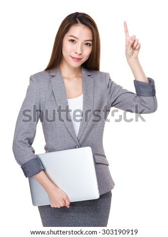 Young businesswoman hold with laptop computer and finger up - stock photo