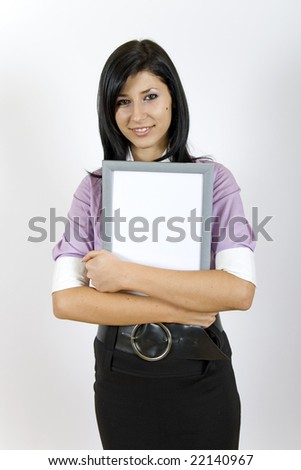 young businesswoman holding a blank frame