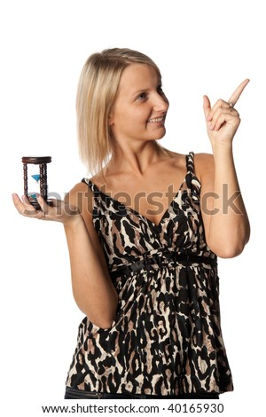 Young businesswoman holding a hourglass on  a white  background.  Time is running out. - stock photo