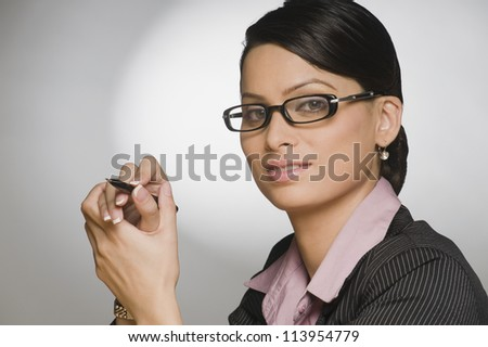 Young businesswoman holding a pen