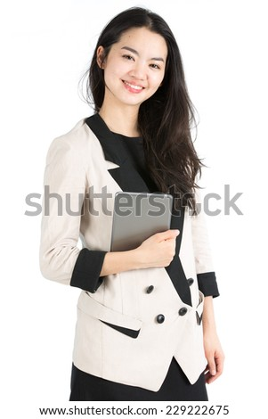 Young businesswoman holding a tablet - stock photo