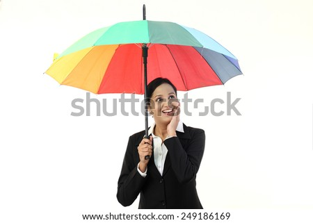 Young businesswoman holding a umbrella - stock photo