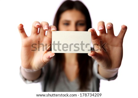 Young businesswoman holding blank business card isolated on white background