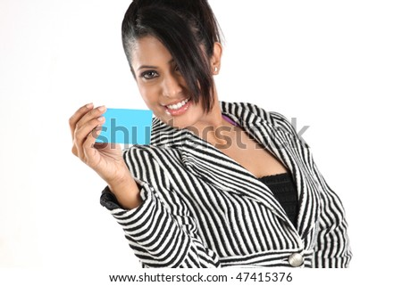 Young businesswoman holding blue credit card - stock photo