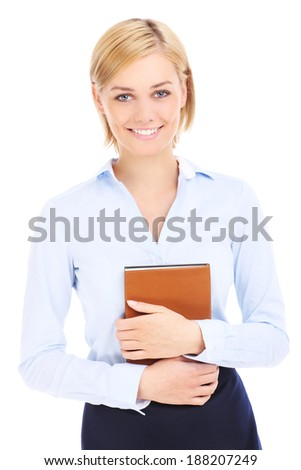 Young businesswoman holding brown book over white background