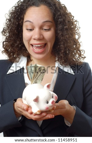 Young businesswoman holding cash-filled piggybank and rejoicing
