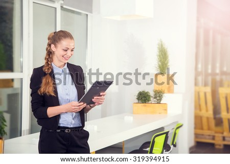 Young businesswoman holding digital tablet. Business woman holding tablet computer or touch pad. Woman professional sale manager. Wait for the end of the working day. Perform task or conduct research. - stock photo