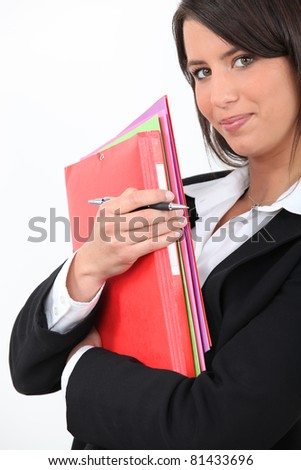 Young businesswoman holding folders - stock photo