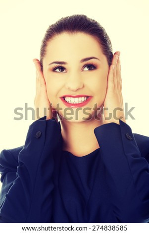 Young businesswoman holding her head - stock photo