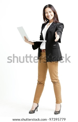 Young businesswoman holding her laptop giving a handshake