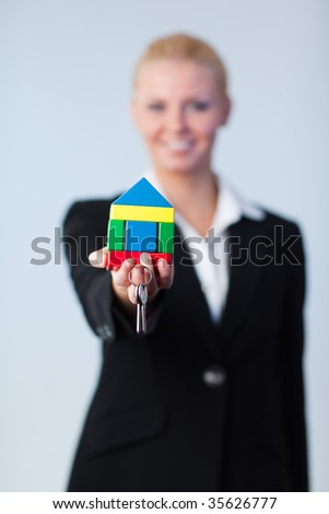 Young Businesswoman holding house and dollars - stock photo