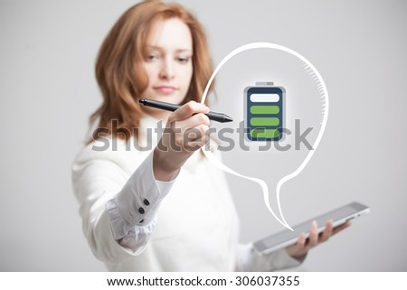 Young Businesswoman holding tablet and pen, battery level icon - stock photo
