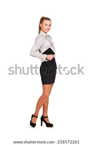 Young businesswoman holding tablet computer on white background. working on touching screen.  - stock photo