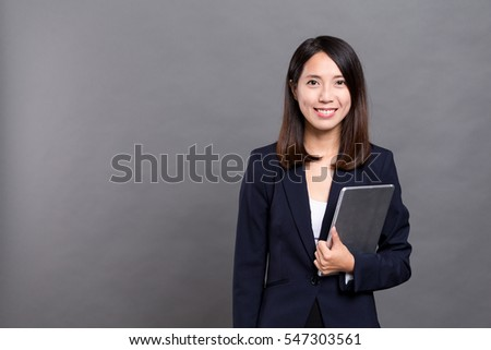 Young businesswoman holding with tablet computer