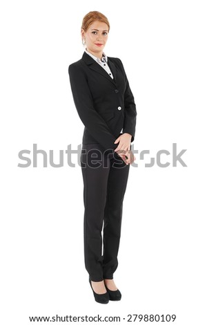 Young businesswoman in black suit isolated on white background, full length portrait - stock photo