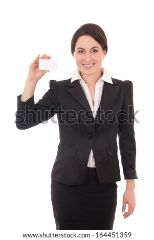 young businesswoman in black suit showing a blank business card isolated on white background