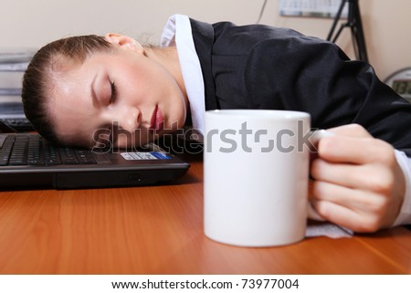 Young businesswoman in black suit sleeping on the laptop - stock photo