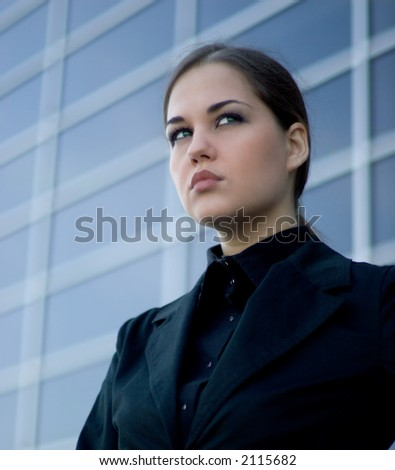 Young businesswoman in front of a modern office building - stock photo