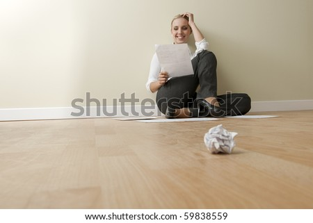 Young businesswoman in her empty bew office