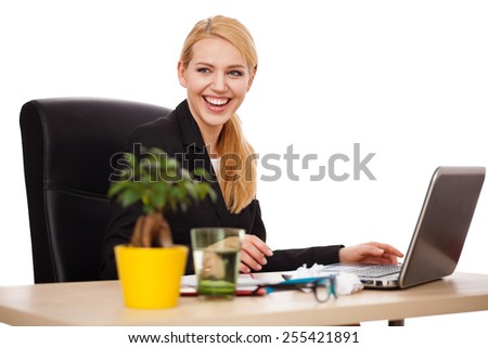 Young businesswoman in her office, white background - stock photo