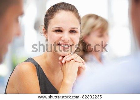 Young businesswoman in meeting - stock photo