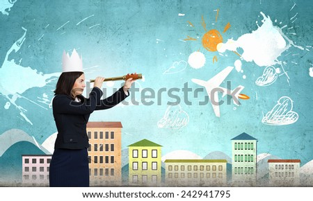 Young businesswoman in paper crown looking in spyglass - stock photo