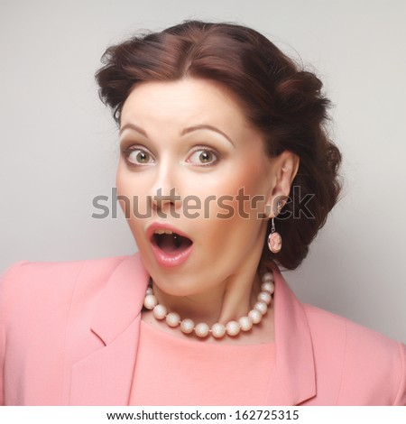 young businesswoman in pink - stock photo