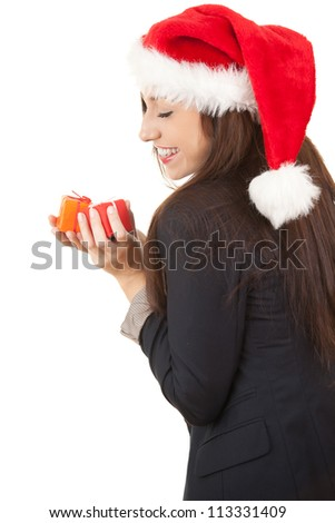 young businesswoman in santa claus hat with gift, white background - stock photo