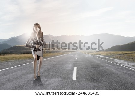 Young businesswoman in start position ready to run - stock photo