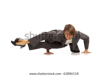 Young businesswoman in suit doing yoga Side Crow Pose - stock photo