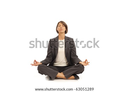 Young businesswoman in suit practicing yoga