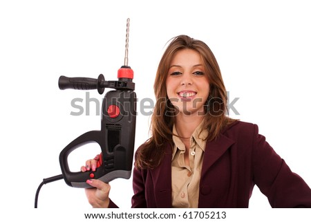 Young businesswoman in suit wielding a pneumatic hammer, conceptual image
