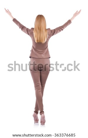 Young businesswoman in suit  with raised hands isolated on white - stock photo