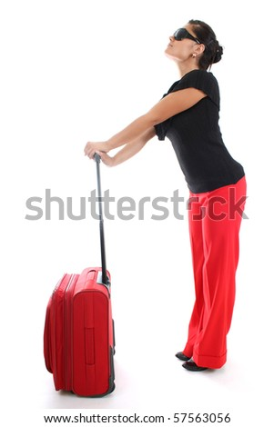 young businesswoman in sunglasses with big red suitcase - stock photo