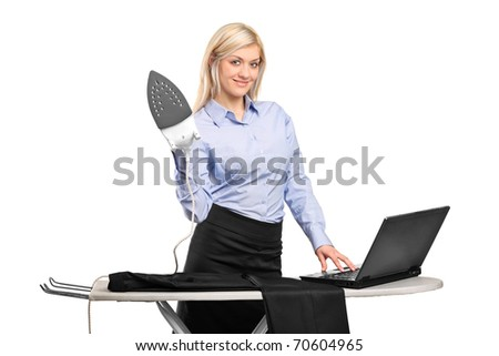 Young businesswoman ironing his clothes and working on a laptop isolated against white background - stock photo