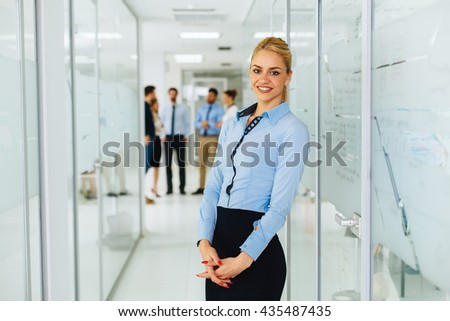 Young businesswoman is posing in hallway - stock photo