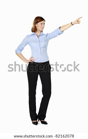 Young businesswoman isolated on a white background smiling and pointing into the distance - stock photo