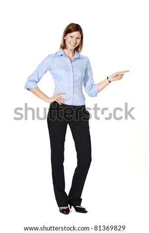 Young businesswoman isolated on a white background smiling, pointing to the left, making fun of someone/something