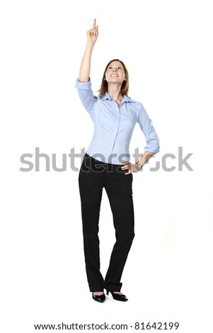 Young businesswoman isolated on a white background standing, smiling, pointing and looking up