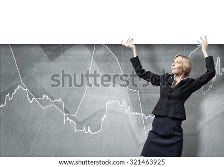 Young businesswoman lifting white blank banner above head