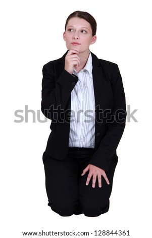 young businesswoman looking pensive - stock photo
