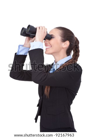 young businesswoman looking through binoculars,  isolated over white background