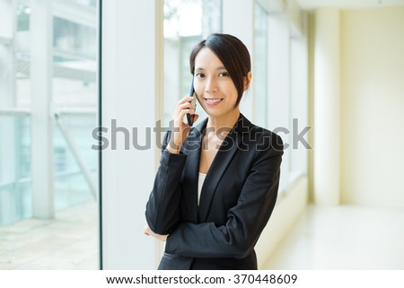Young Businesswoman make a call