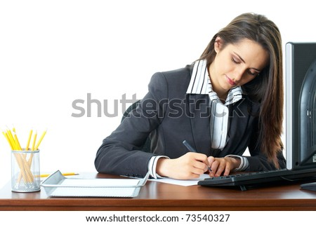 young businesswoman make some notes, dark wooden desk with keyboard and monitor on it, isolated on white - stock photo