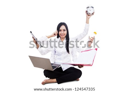 Young businesswoman multitasking isolated on white - stock photo