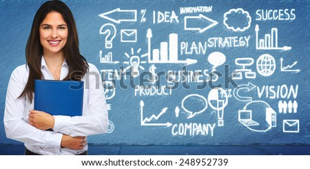 Young businesswoman near business scheme background. - stock photo