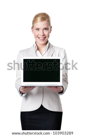 Young businesswoman offers computer product, isolated on white
