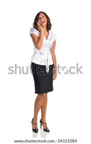 Young businesswoman on the cell phone isolated on a white background - stock photo